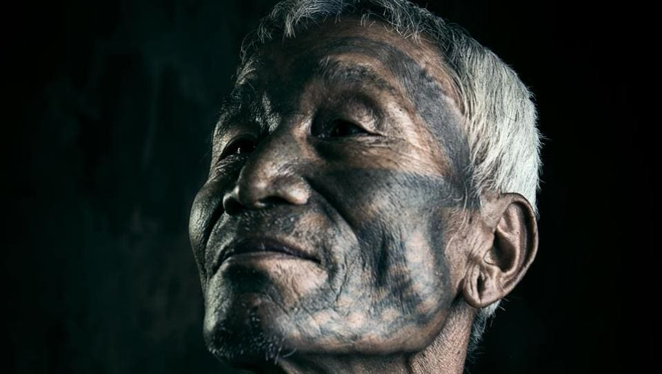 Image of a Naga men displaying his tattooed face that is part of the Another India exhibition at the University of Cambridge's Museum of Archaeology and Anthropology that focusses on India's most marginalised citizens.