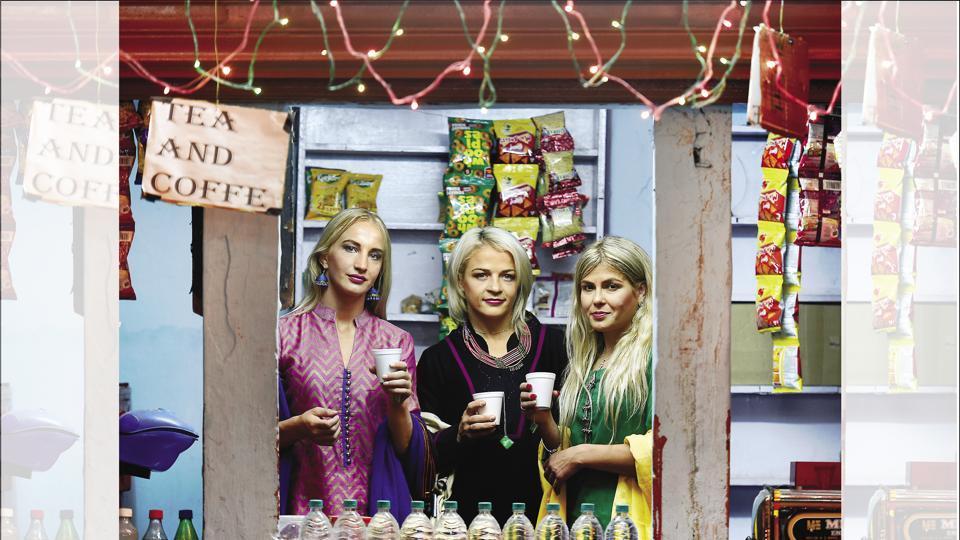 International wrestling champions Sofia Mattson, Mariya Stadnik and Yana Rattigan sipping tea inside a chai shop at Chandni Chowk