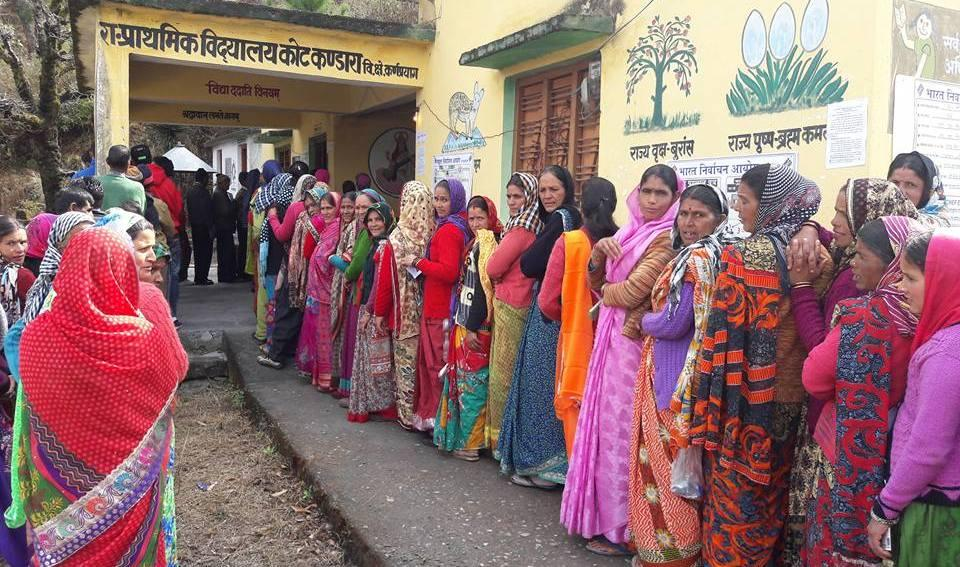 Women queue up to cast their vote at a polling centre in Karnaprayag on Thursday.