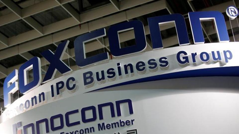 Logos of Foxconn and Ennoconn are seen during the annual Computex computer exhibition in Taipei, Taiwan