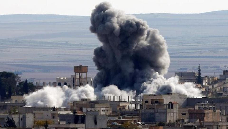 At least 20 civilians, including some children, were killed in suspected U.S.-coalition airstrikes on a village east of the Islamic State group's de-facto capital in Syria
