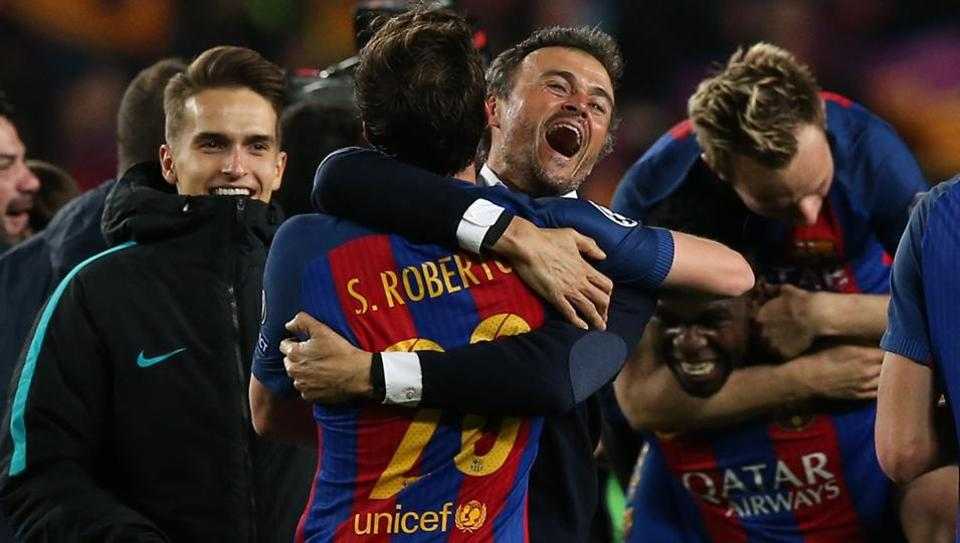 FC Barcelona coach Luis Enrique and Sergi Roberto celebrate after win over Paris Saint-Germain in UEFA Champions League.