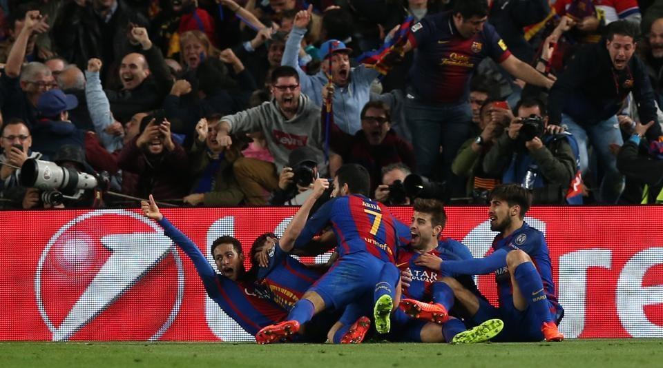 FC Barcelona players celebrate after defeating Paris Saint-Germain in a UEFAChampions League last 16 clash.