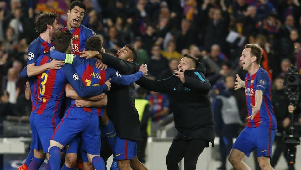 FC Barcelona players celebrate after defeating Paris Saint-Germain in a UEFA Champions League round of 16 match.
