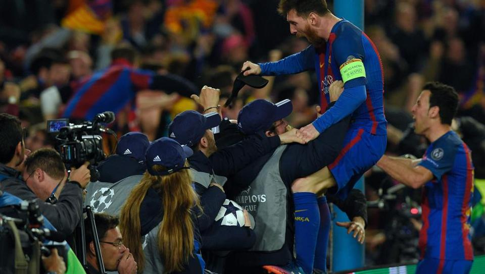 FC Barcelona's Lionel Messi and Sergio Busquets celebrate their victory over Paris Saint-Germain in the UEFA Champions League.
