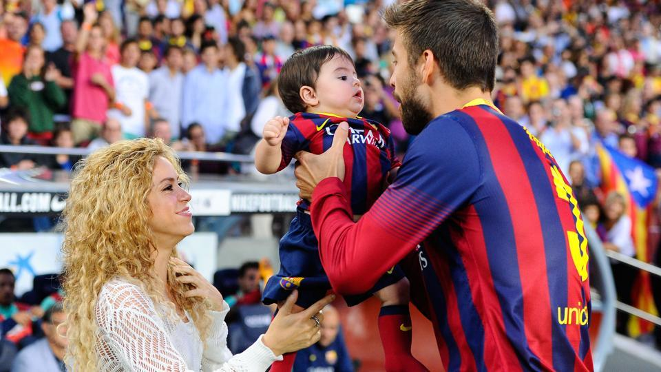 Shakira and Gerard Pique of FC Barcelona are seen with their son Milan in this September 2013 file picture.