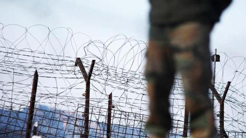 An Indian army soldier patrols near the line of control in Poonch district, about 210 kilometers from Jammu.