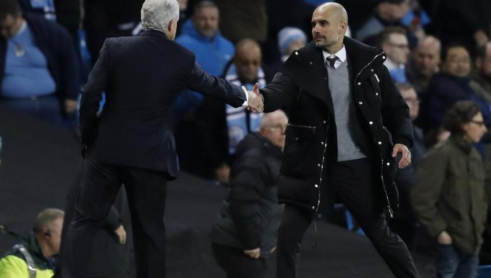 Stoke City manager Mark Hughes shakes hands with Manchester City manager Pep Guardiola after a drawn Premier League game.