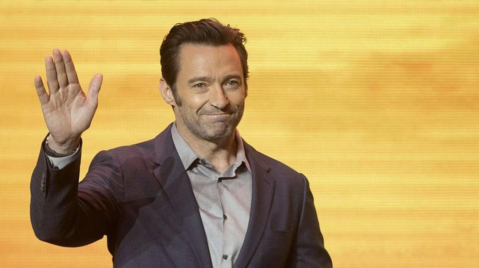 Actor Hugh Jackman waves as he arrives for a press conference for the movie Logan in Beijing.