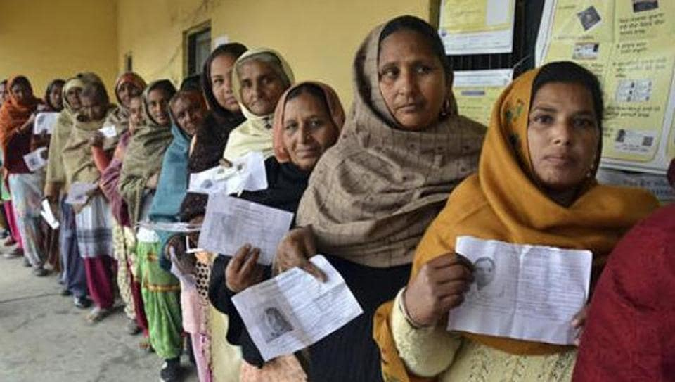 Women queue up with their election identity cards as they wait to cast their votes in Amritsar for the Punjab assembly election on February 4, 2017.
