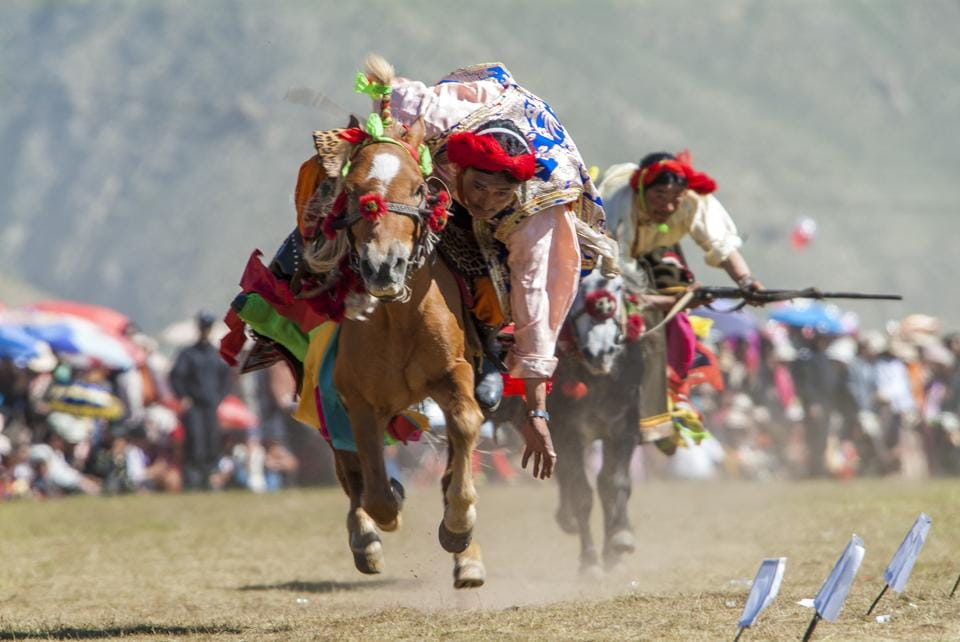 YUSHU, QINGHAI, CHINA - 2004/04/14: Khampa horseman at the Yushu Horse Racing Festival in Qinghai in Eastern Tibet.