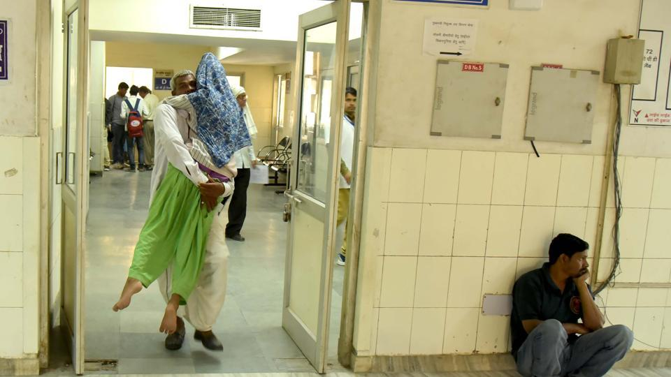 A patient is being carried by a relative at SMSHospital on Thursday.