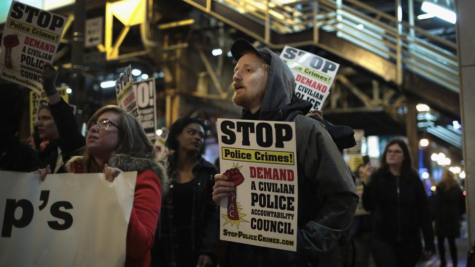 Demonstrators march through the Loop protesting immigration and other policies instituted by the administration of President Donald Trump in Chicago, Illinois.