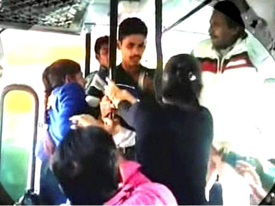 A video grab of the two sisters attacking one of the men in the bus. The 'eve-teasers' were later let off by a local court. (PTI / File photo)