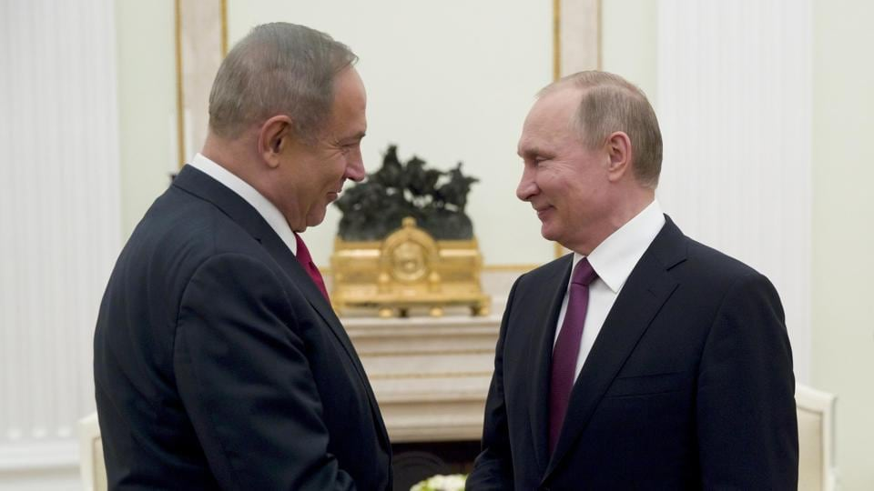 Russian President Vladimir Putin (R) shakes hands with Israeli Prime Minister Benjamin Netanyahu during a meeting in Moscow, Russia, March 9, 2017.