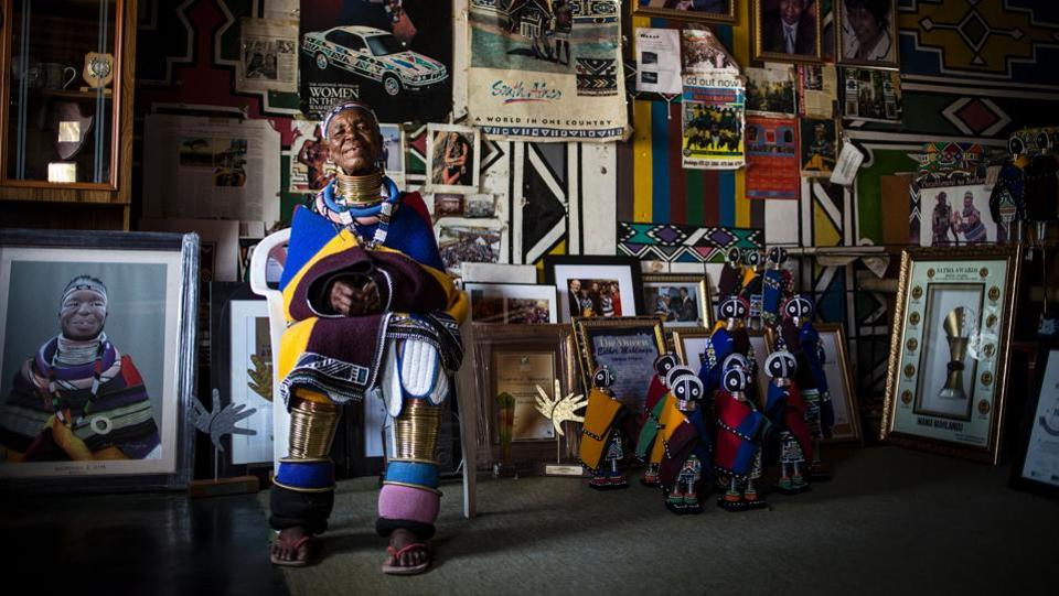 Esther's contribution to South African contemporary art and the impression that she has left on so many people globally as she travels adorned in traditional Ndebele dress makes her a national treasure. (GULSHAN KHAN / AFP)