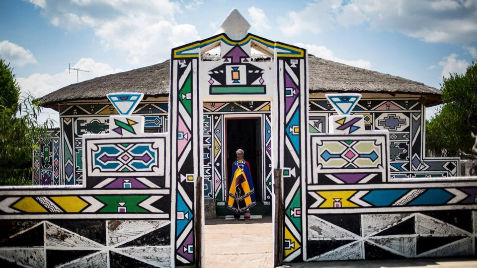 South African artist Esther Mahlangu, 81, poses at her home in Mabhoko Village, Siyabuswa, Mpumalanga . Mahlangu recently opened her exhibition at the Melrose Gallery where her series of artwork inspired by Nelson Mandela was unveiled on March 1. The artist has produced six paintings reproduced from drawings created by Mandela in her signature Ndebele style. The exhibition will include previous work by Mahlangu. Created in 2004, Esther says it remains one of the most rewarding collaborations of her long and illustrious career. (AFP)