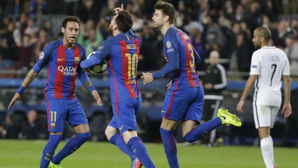 Barcelona's Gerard Pique (right) celebrates with Lionel Messi (centre) and Neymar after FC Barcelona's goal against Paris-Saint Germain in UEFA Champions League.