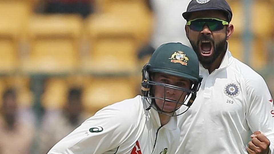 Virat Kohli has been accused by an Australian paper of hurling a bottle at an Australian official during the Bangalore Test.