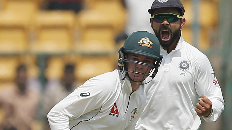 Australia batsman Peter Handscomb (front) had drawn the ire of India captain Virat Kohli for suggesting his captain Steve Smith to take help from the dressing room on an lbw appeal in the Bangalore Test.