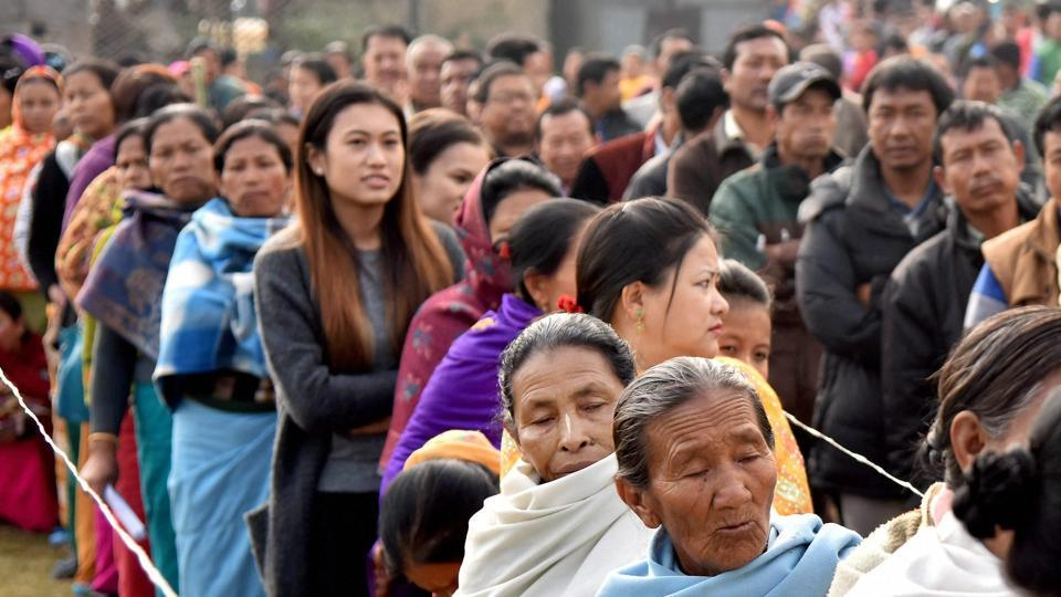 People stand in a queue to cast their votes in the last phase of Manipur election. Polling in five states ended on Wednesday.