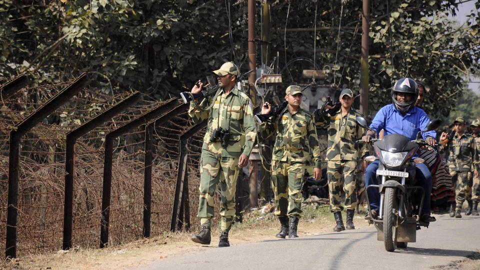 BSF personnel on a routine patrol along the India-Bangladesh border in Lankamura on the outskirts of Agartala. Twelve Bangladeshis illegally crossed the border and tried to rob Indian villagers on Wednesday night.