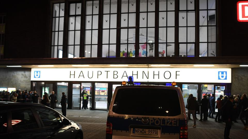 Policemen secure the area around a train station after an axe attack on passengers at the main train station on March 9 in Duesseldorf, Germany.