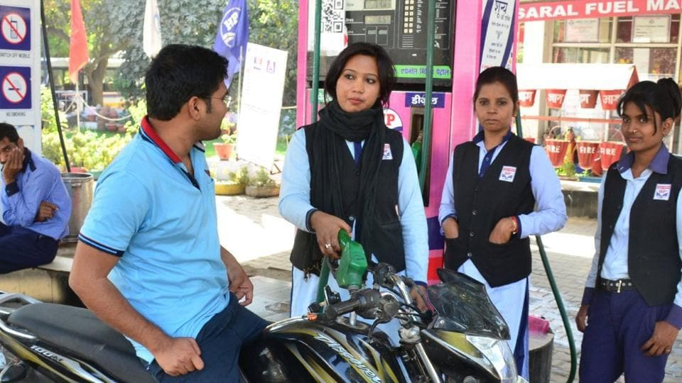 Women workers at pink petrol pump.