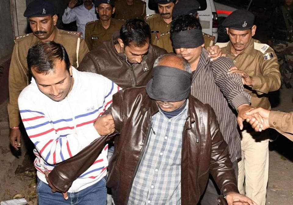Members of the special investigation team with arrested accused of BSSC paper leak case, in Patna.