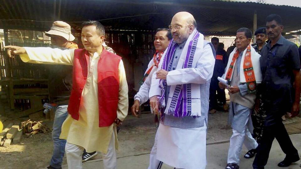 BJP President Amit Shah during a door to door election campaign in Wangkhei constituency of Imphal East district in Manipur on March 1 as BJP looks to make inroads in the north-eastern state. (PTI)
