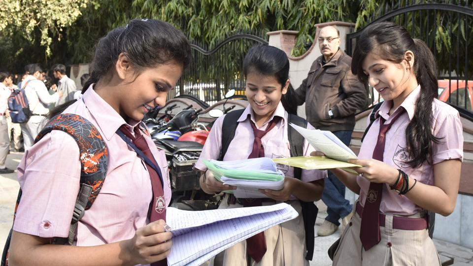 Students preparing in last minutes as they wait outside their examination centre to take the CBSE Board exams at Evergreen School, Vasundhra Enclave in New Delhi on March 9, 2017.