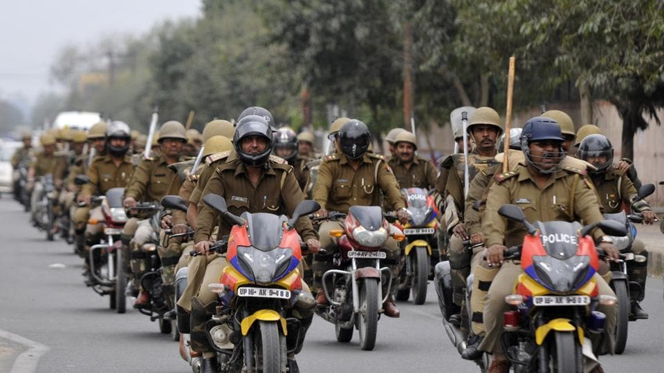 Noida Police during a bike rally on the eve of counting day of UP elections in Noida. (Sunil Ghosh/ht photo)