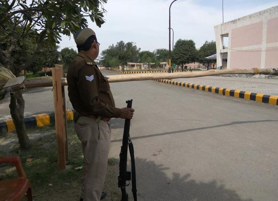 Tight security for EVM strong rooms at the flower market in Noida.