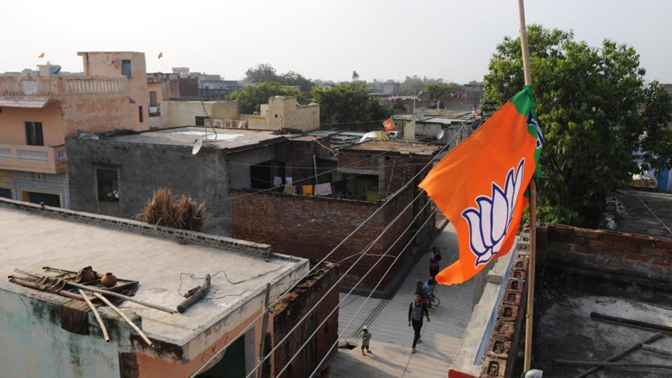 The flag of the Bharatiya Janata Party (BJP) seen on top of a residential house, in Dadri Greater Noida, India. (Burhaan Kinu/HT PHOTO)