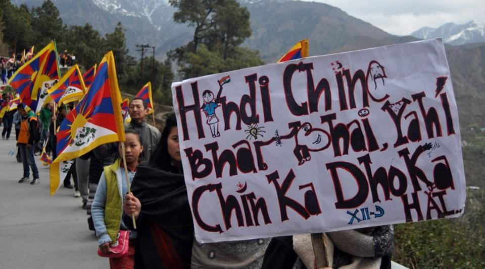 Tibetans offer tribute to the Tibetan Martyrs who sacrificed their lives for freedom of Tibet. (Shyam Sharma / HT Photo)