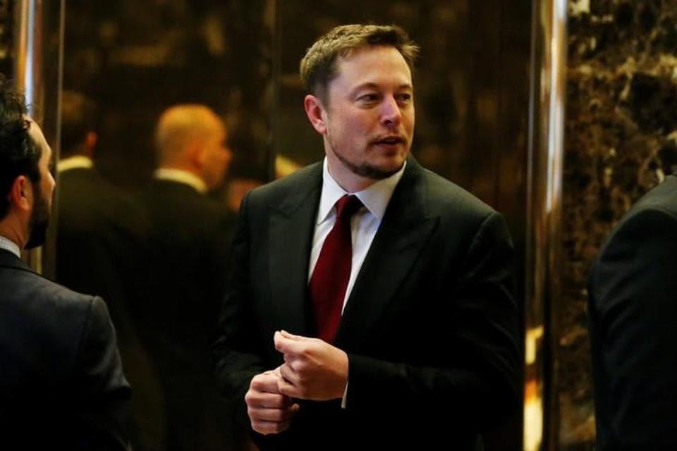 Tesla Chief Executive, Elon Musk enters the lobby of Trump Tower in Manhattan, New York.