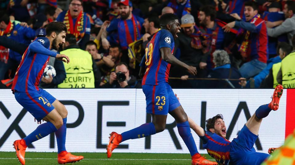 FC Barcelona's Sergi Roberto (R) celebrates with teammates after scoring the winning goal against Paris Saint-Germain FC in an UEFA Champions League round of 16 match.