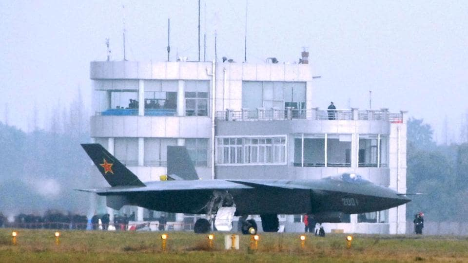 This file photo taken on January 6, 2011 shows China's new stealth fighter jet, the J-20, the country's first radar-evading combat aircraft, during one of many test runs at the military airbase in Chengdu, southwest China's Sichuan province. China has put its first stealth fighter into military service, in the latest milestone highlighting the modernisation of the country's armed forces.