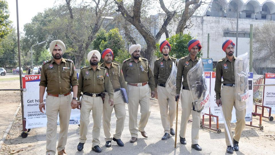 Police personnel standing guard outside Indoor Gymnasium at Punjab Agricultural University in Ludhiana on Friday.