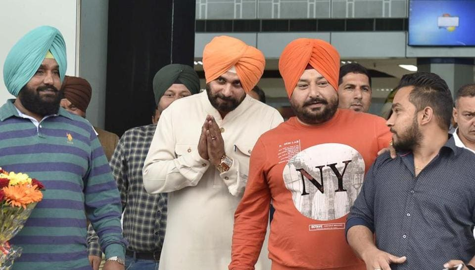 Congress candidate and party's star campaigner Navjot Singh Sidhu arrives at Amritsar Airport on Friday.