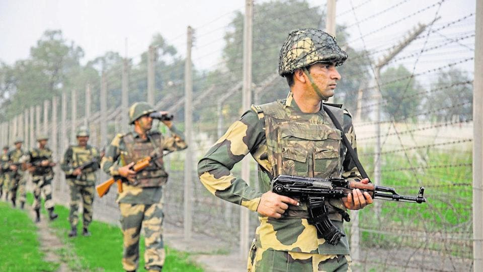 Border Security Force soldiers patrol near the India-Pakistan international border area at Gakhrial boder post in Akhnoor sector, about 48 kilometers from Jammu.
