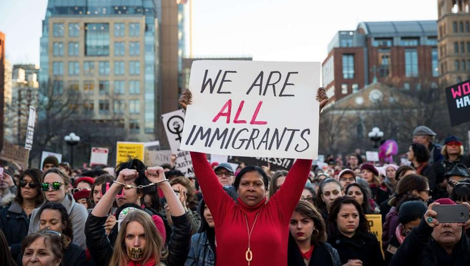 A protester holds up a sign supporting immigrants during a rally in New York City.