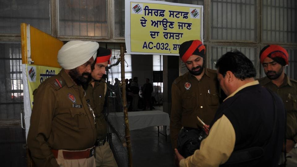 Police officials outside a counting centre in Jalandhar on Friday.