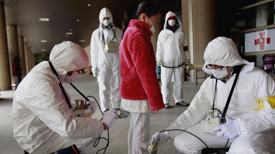 A young evacuee is screened at a shelter for leaked radiation from the tsunami-ravaged Fukushima Dai-ichi nuclear power plant in Fukushima on March 24, 2011.