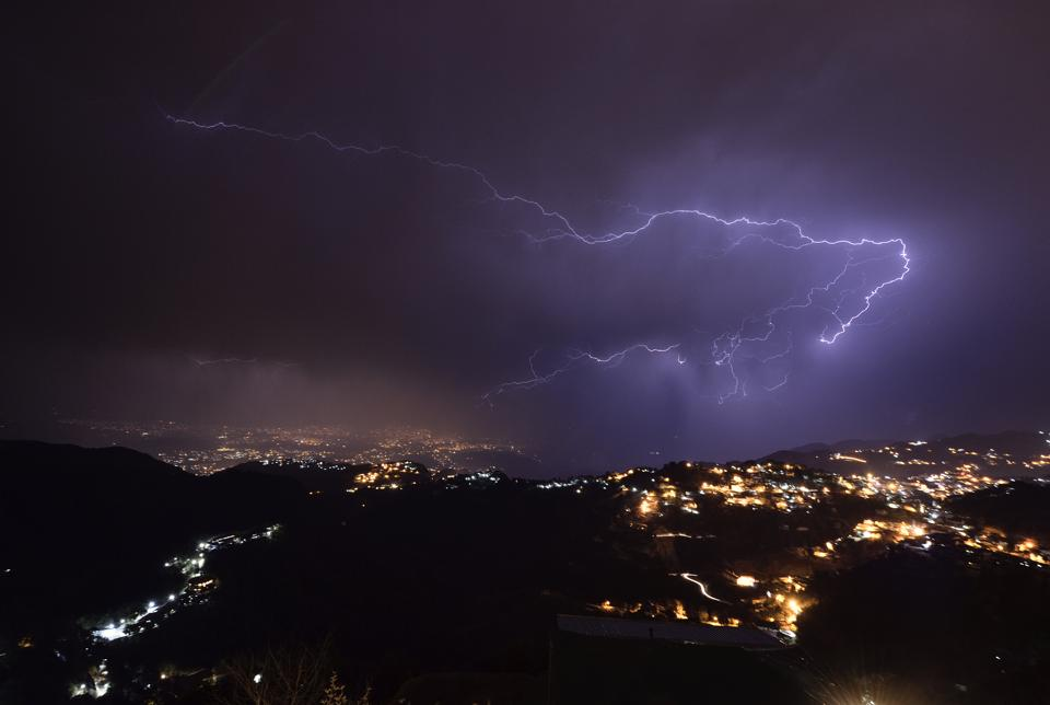 Lightning streaks through the sky over the city of Dehra Dun as seen from Landour on February 20,2017.  Himachal Pradesh and Uttarakhand may see hail and squall  on Friday. (Gurinder Osan/HT PHOTO)