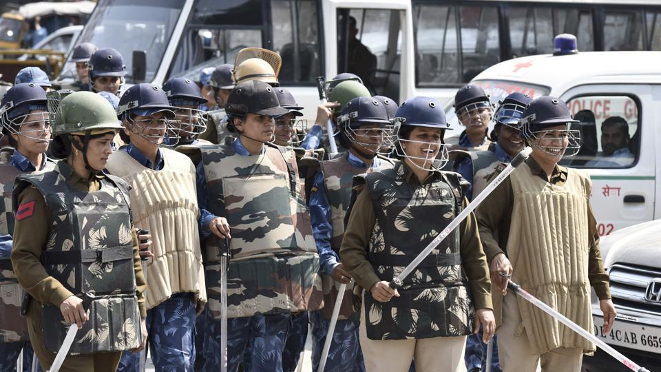 The entrance to the court was barricaded and over 300 police personnel, including women constables, were deployed with batons, helmets and shields.