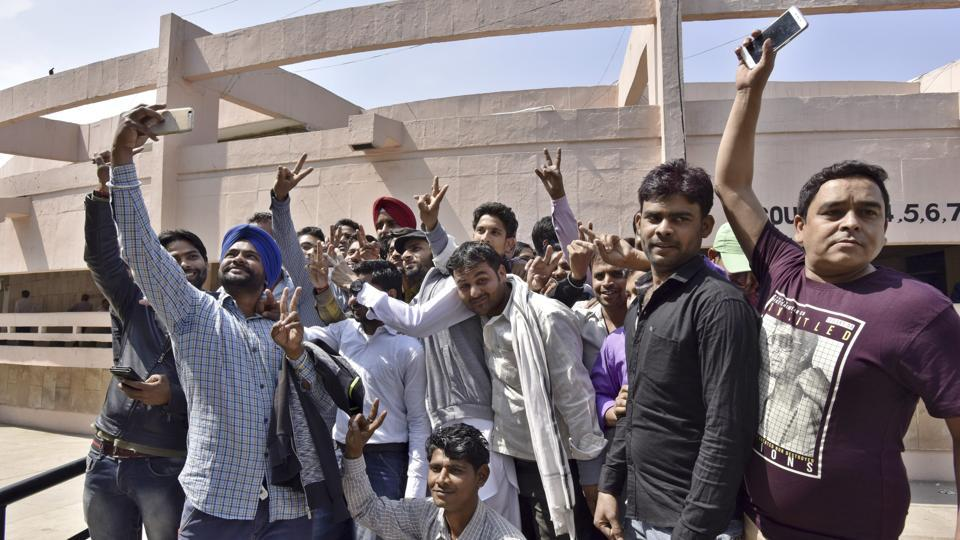 Workers at Maruti's Manesar factory celebrate after being acquitted in the case on Friday.