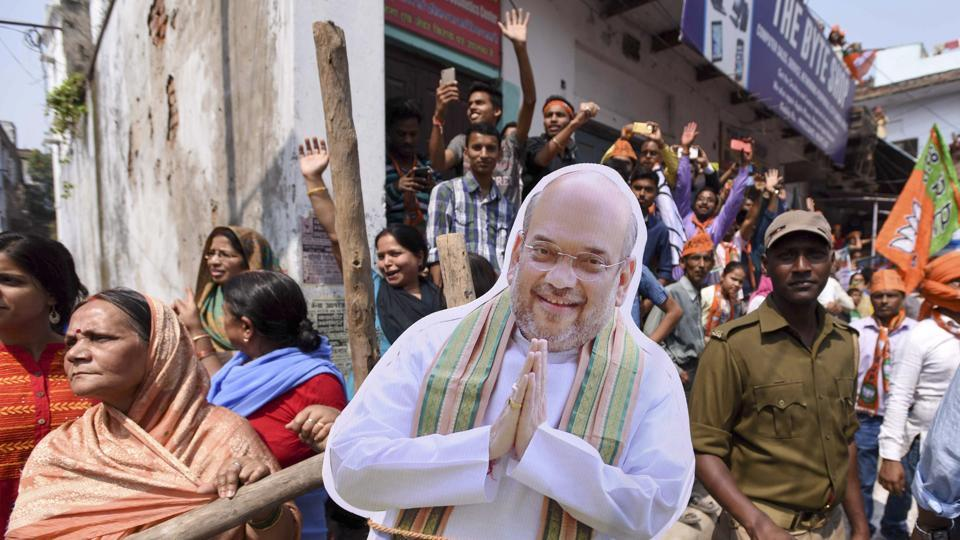 An Amit Shah cutout joins enthusiastic supporters at PM Modi's road show in Varanasi on March 4th.  (Arun Sharma/HT PHOTO)