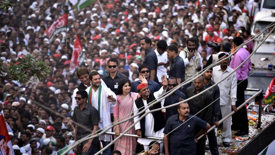 Varanasi, India - March 4, 2017: UP chief minister Akhilesh Yadav, his wife Dimple, and Congress vice-president Rahul Gandhi during their roadshow in Varanasi on March 4, 2017.