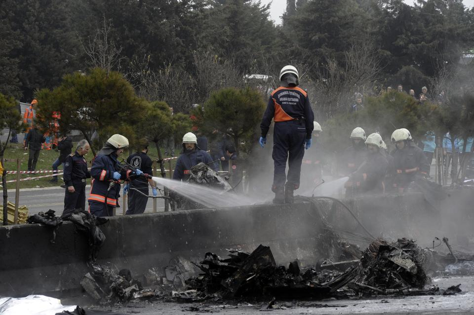 Firefighters at the site of the crash on Friday.